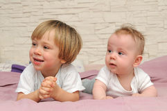 Cute little brothers. Having fun in bed Stock Photo