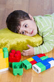 Cute little brunette child is playing with toys Stock Image