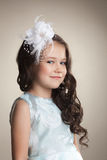 Cute little brunette with decoration in her hair Royalty Free Stock Image