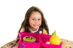Cute little brunette girl with her healthy. Lunchbox isolated on white Stock Images