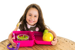 Cute little brunette girl with her healthy. Lunchbox isolated on white Royalty Free Stock Photos