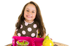 Cute little brunette girl with her healthy Stock Image