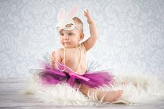 Cute little bunny. Cute baby girl with bunny ears - studio shot Royalty Free Stock Photos