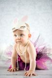 Cute little bunny. Cute baby girl with bunny ears - studio shot Stock Images