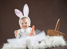 Cute little bunny with carrot. And basket Stock Photo
