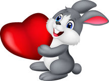 Cute little bunny cartoon holds red hart Royalty Free Stock Photos