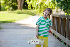 Cute little caucasian boy, eating strawberries in the park Royalty Free Stock Photography