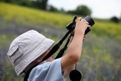 Cute little caucasian boy taking photos outdoor Royalty Free Stock Photos