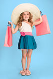 The cute little caucasian brunette girl in dress holding shopping bags Royalty Free Stock Photo