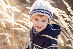 Cute little caucasian child, boy, holding fluffy toy, hugging it Royalty Free Stock Image