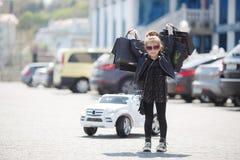 Cute little caucasian girl child having shopping fun. stock image
