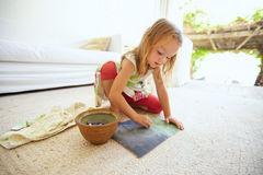 Cute little caucasian girl drawing at home Stock Photo