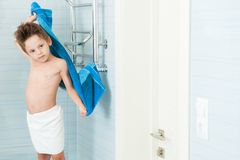 Free Cute Little Caucasian Sport Boy With Wet Hair Drying Off His Body With Blue Towel In Bright Bathroom Stock Images - 166824894