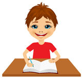 Cute little caucasian student boy writing Royalty Free Stock Photography