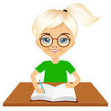 Cute little caucasian student girl writing Stock Photos