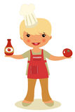 Cute little chef. Holding ketchup and tomato Royalty Free Stock Images