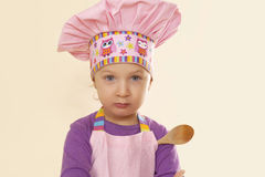 Cute little chef. Cute little baby girl chef looking in camera Royalty Free Stock Images
