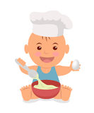 Cute little chef. Toddler in a cook cap with a spoon and an egg in the hands knead the dough. Stock Image