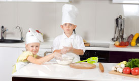 Cute Little Chefs Baking in Kitchen Royalty Free Stock Photo