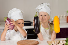 Cute Little Chefs Holding Huge Vegetables Royalty Free Stock Photo