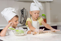 Cute Little Chefs Preparing for Pizza. In the Kitchen stock images