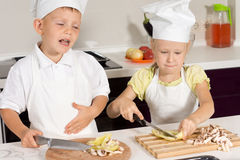 Cute Little Chefs Slicing Pizza Ingredients Royalty Free Stock Photography