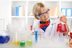 Cute little chemist Stock Images