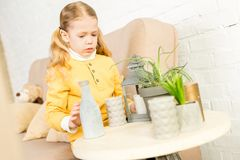 Cute little child arranging objects on table. During relocation royalty free stock photos