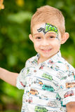 Cute little child boy with aqua make-up in park on nature at summer. Use it for baby, parenting or love conce Stock Photo