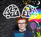 Cute little child boy on blackboard with science formula and hand drawing art pattern.  stock photo