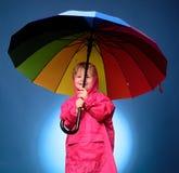 Cute little child boy are getting ready for autumn. Kid having fun with Leaf fall. Cloud rain umbrella. Raining concept royalty free stock photos