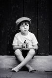 Cute little child, boy, holding big metal key and a book, willin Royalty Free Stock Photos