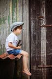 Cute little child, boy, holding big metal key and a book, willin Royalty Free Stock Photography
