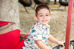 Cute little child boy in park on nature at summer. Use it for baby, parenting or love conce Stock Images