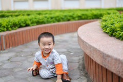 Cute little child boy play hide and seek game. Happy kid having fun while play hide and seek game in the park Royalty Free Stock Photography