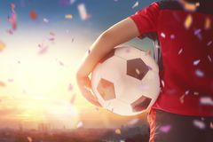 Boy playing football. Cute little child dreaming of becoming a soccer player. Boy playing football on sunset Stock Photos