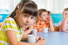 Cute little child drinking milk stock photos