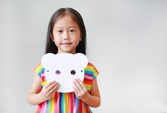 Free Cute Little Child Girl Holding Blank White Animal Paper Mask On Her Chest On White Background. Idea And Concept For Kid Dressed Up Royalty Free Stock Image - 163803706