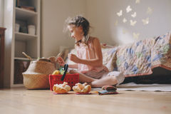 Cute little child girl playing in her room with toy food, cooking and having fun at home Stock Photography
