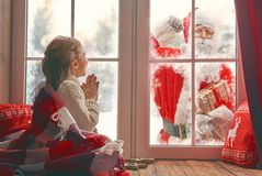 Girl by window at Christmas Royalty Free Stock Photos