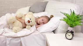 Cute little child girl sleeping with teddy bear stock video