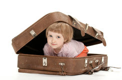 Cute little child inside a big suitcase Stock Images