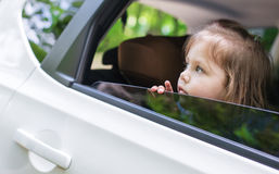 Cute  little child looks out the window Royalty Free Stock Photo