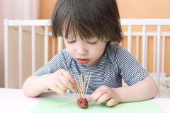 Cute little child made toothpick spines by playdough hedgehog Royalty Free Stock Photos