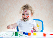 Cute little child painting Stock Image