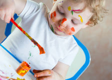 Cute little child painting Stock Photo