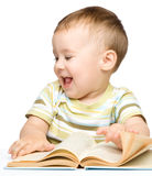 Cute little child play with book Stock Image