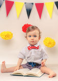 Cute little child play with a book Royalty Free Stock Image