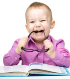 Little child play with book Royalty Free Stock Photos