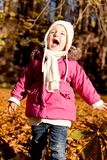 Cute little child playing outdoor in autumn Royalty Free Stock Photos